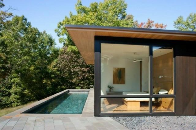 piscina pequeña rectangular lateral casa