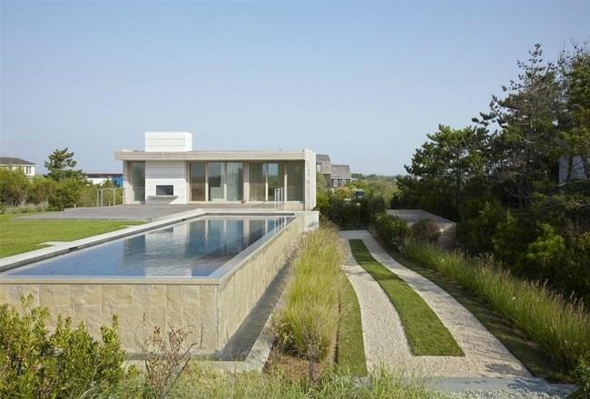piscina piedra gris diseño moderno