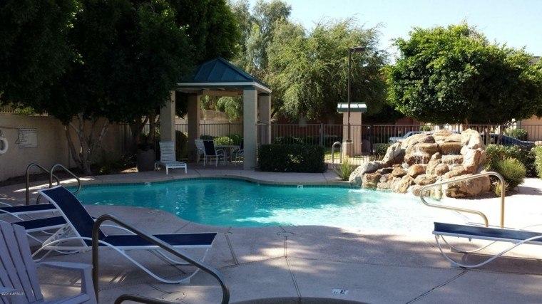piscina rocalla pergola obra jardín