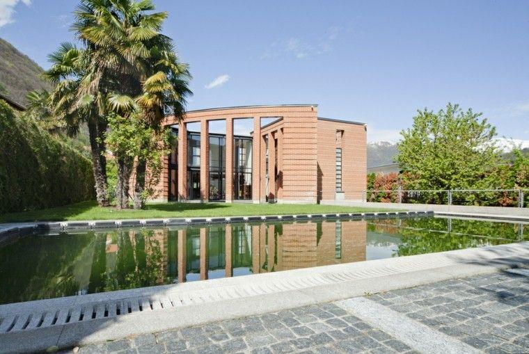 piscinas grandes jardin suelo pavimento cesped palmera ideas