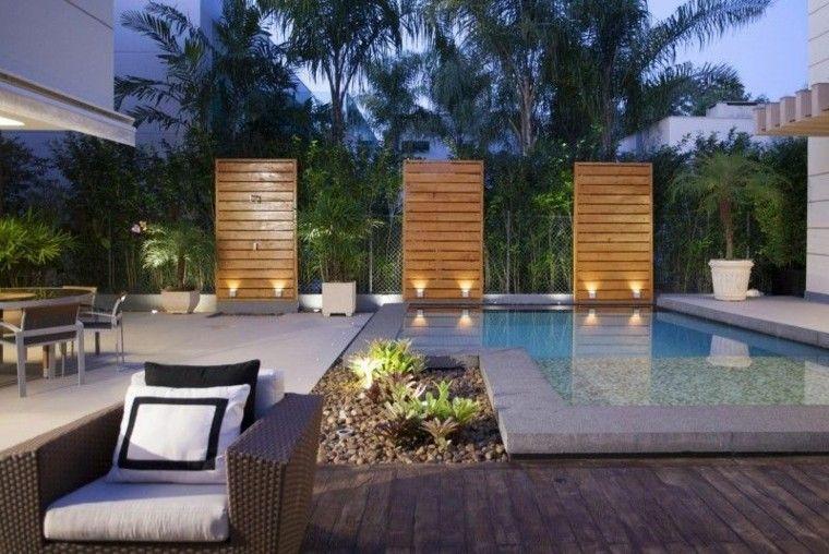 piscinas jardín palmeras macetas iluminado ideas