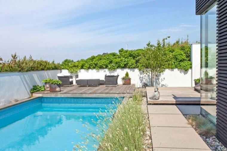 piscinas jardín valla hormigon muebles mimbre ideas