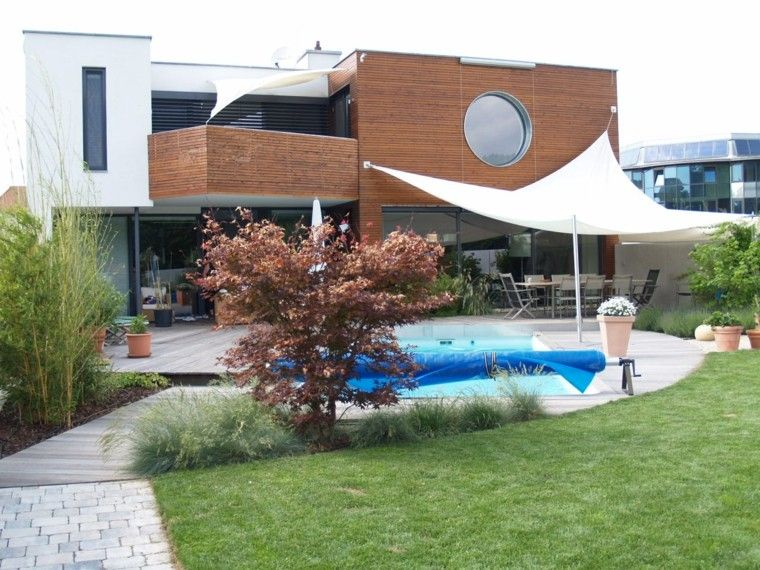 Piscinas jardines e ideas para el relax sin l mites for Plantas para poner cerca de la piscina