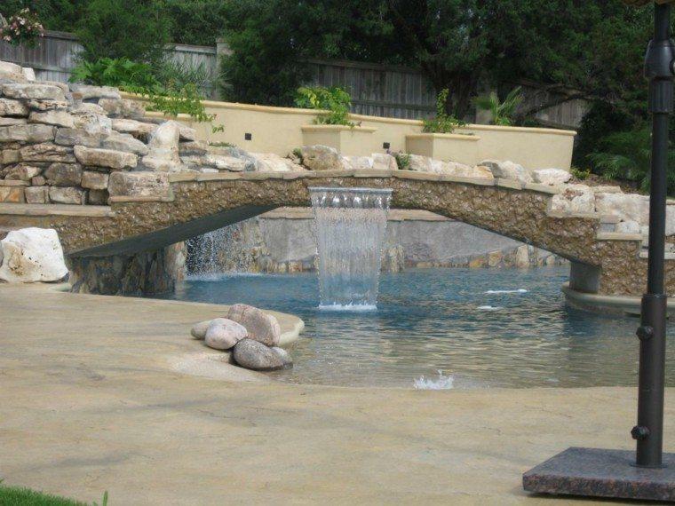 puente piscina piedra cascada piedra