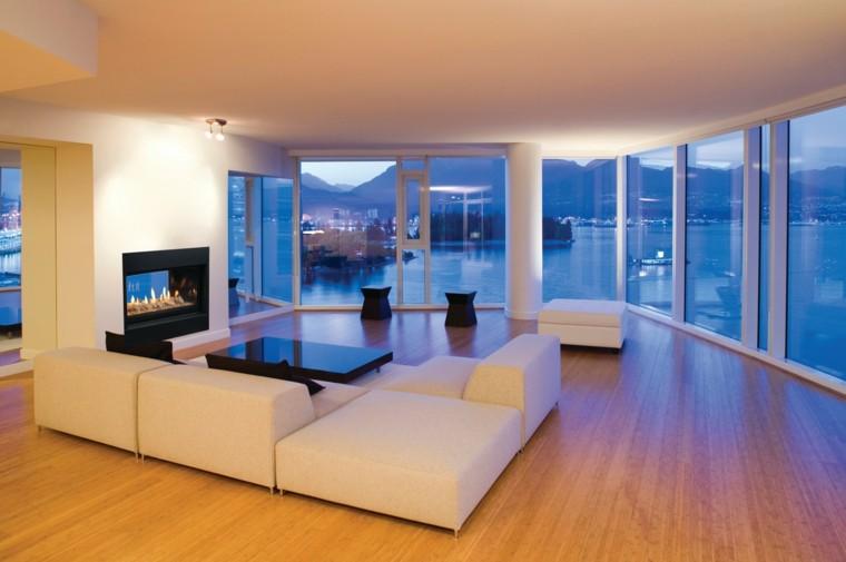 salon amplio paredes cristal azul