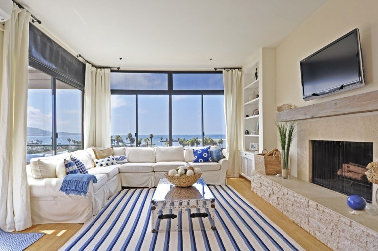 salon moderno blanco azul marino alfombra cojines ideas