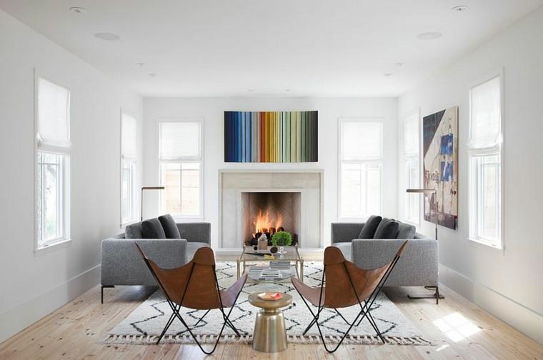 salones de diseño escandinavo chimenea sofas grises ideas