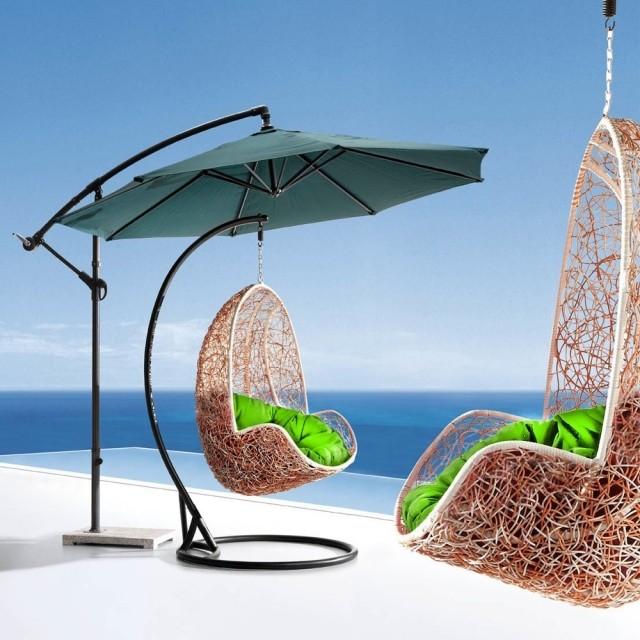 silla colgante parasol verde cojines