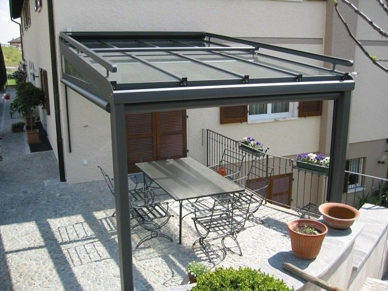 sillas acero mesa encimera cristal patio ideas