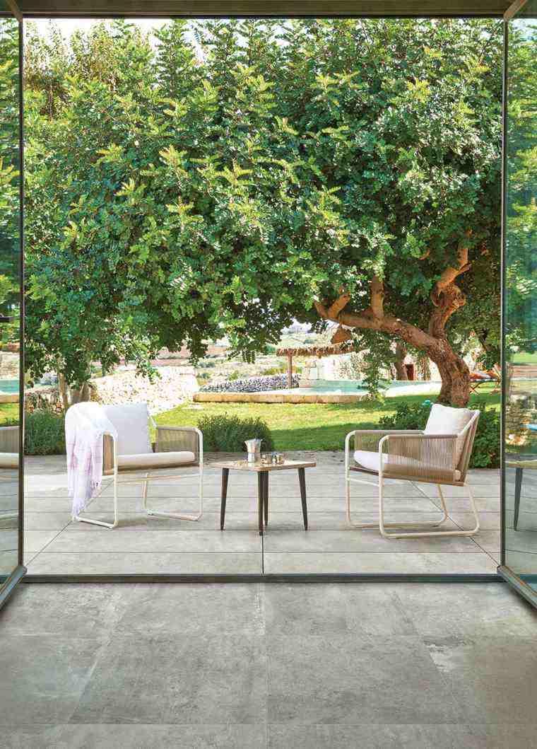 Baldosas para el jard n moderno 50 ideas preciosas for Mesa baja jardin