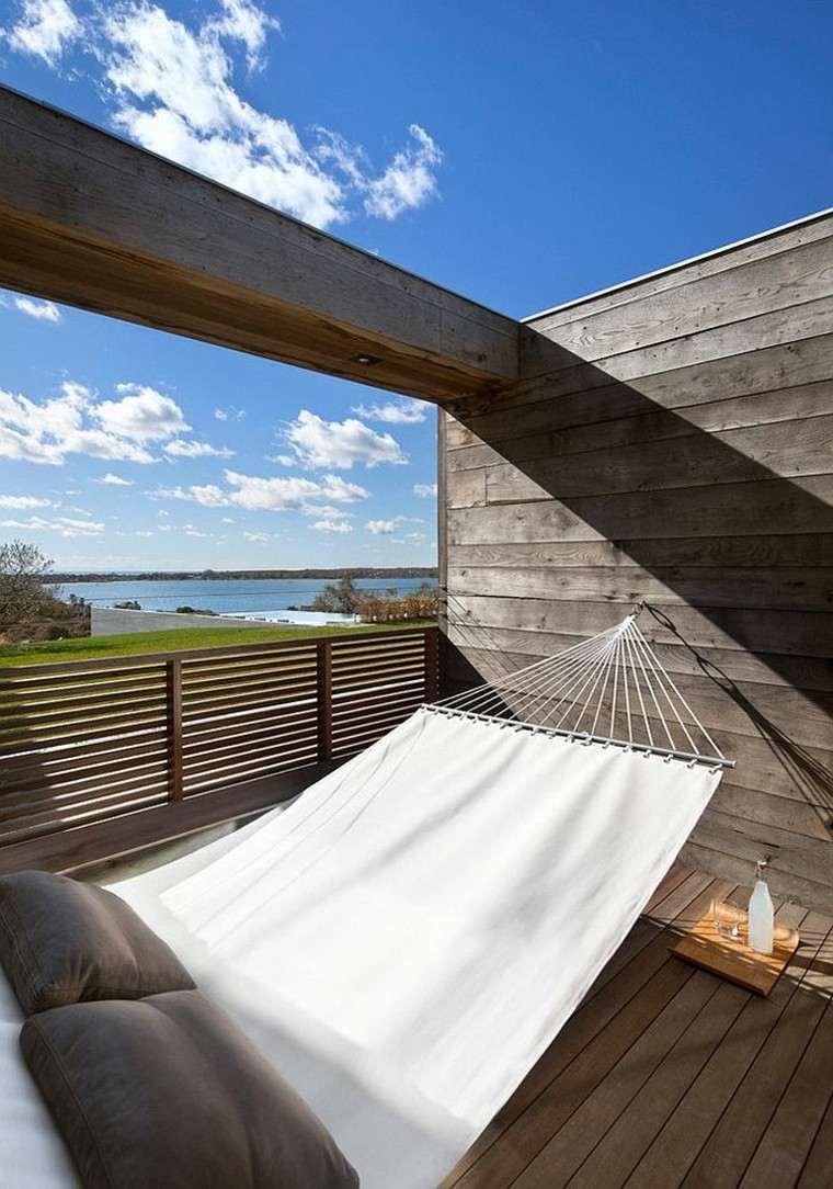 Muebles de jard n hamacas para tu espacio al aire libre for Cojines para hamacas