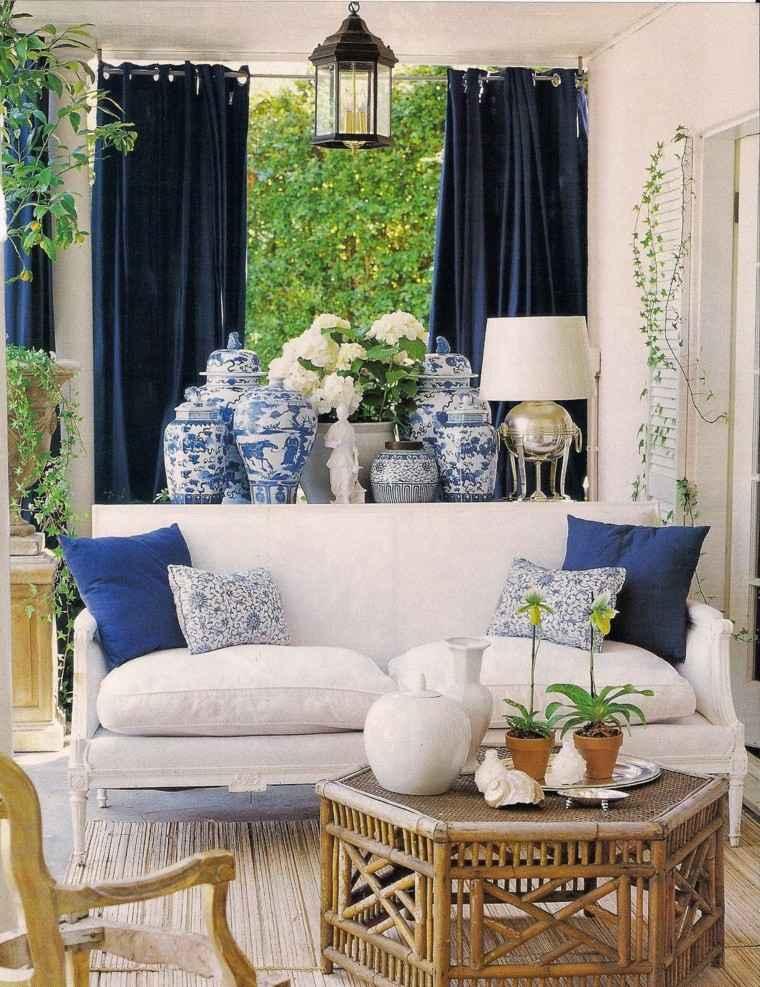 sofas jardín blanca cojines azules ideas