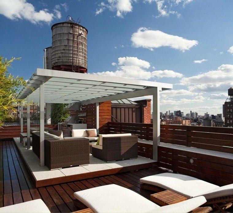 terraza asientos cojines plantas pergolas