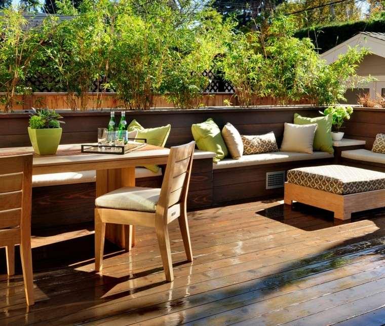 terraza cojines centros verdes madera