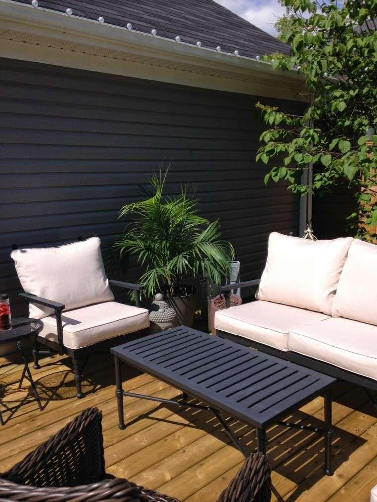 terraza forja mobiliario ratan cojines
