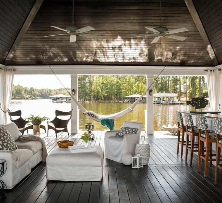 terraza preciosa muebles comodos hamaca vista lago ideas