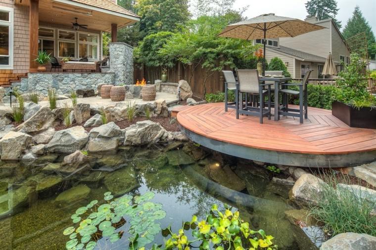 terraza sillas sombrillas plantas rocas muebles
