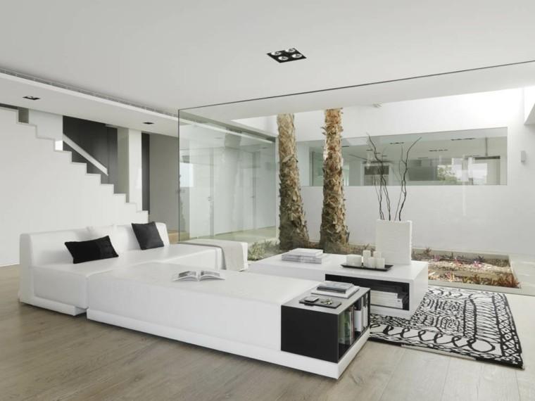 Susanna Cots salon blanco cojines negro ventana ideas