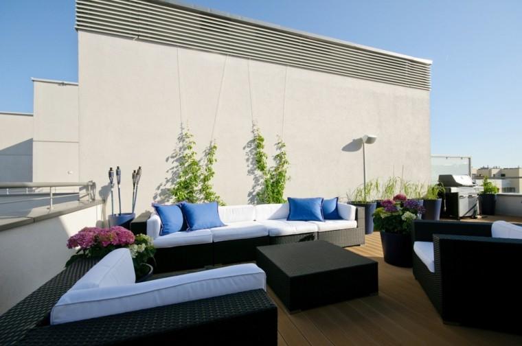 atico terraza sillones mimbre