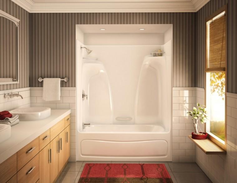 bañera alfombra toallero lavabo blanca