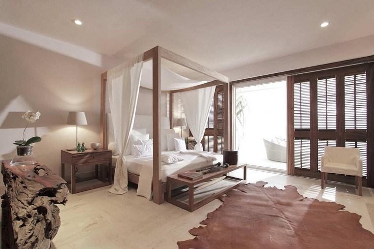 cama dosel madera alfombra cuero dormitorio romantico ideas