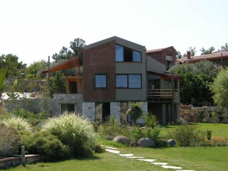 Diferentes estilos de diseño de fachadas de la casa de lujo