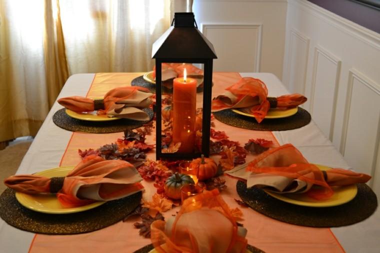 centro mesa una vela naranja