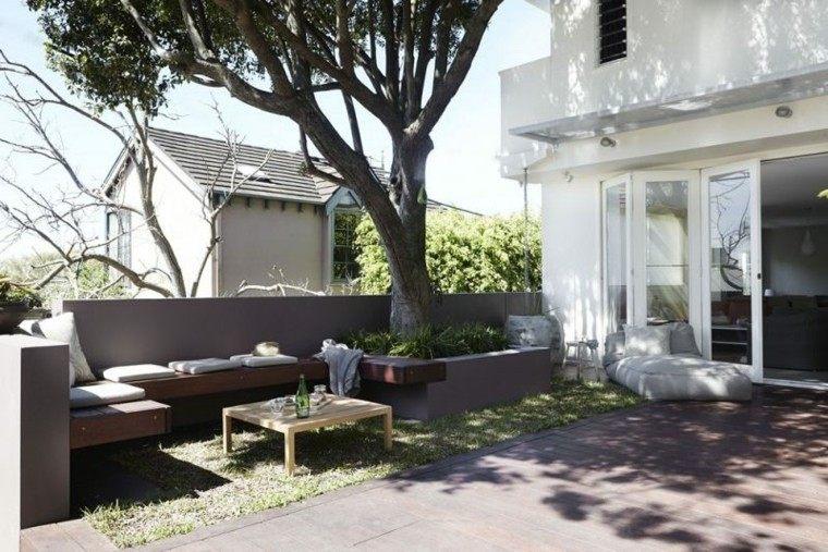 confort patio arboles cojines hormigon