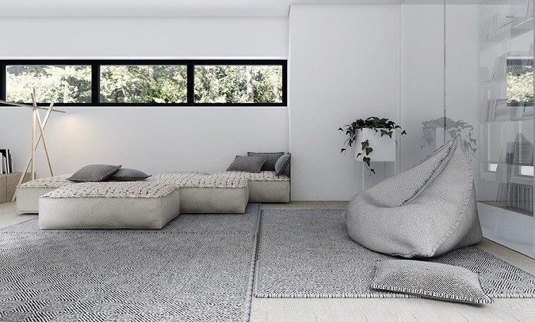 decoración de interiores habitacion descanso cojines alfombra gris paredes blancas ideas