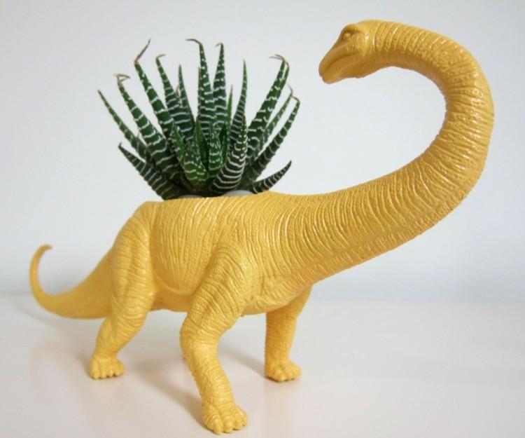 dinosaurio color amarilo planta maceta
