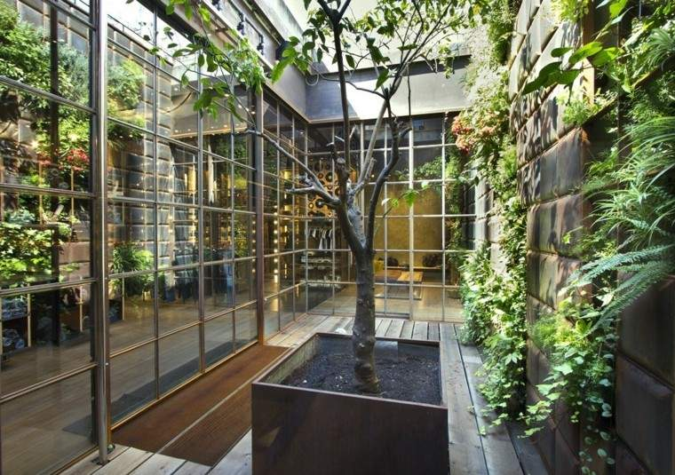 diseño jardines verticales techo ramas