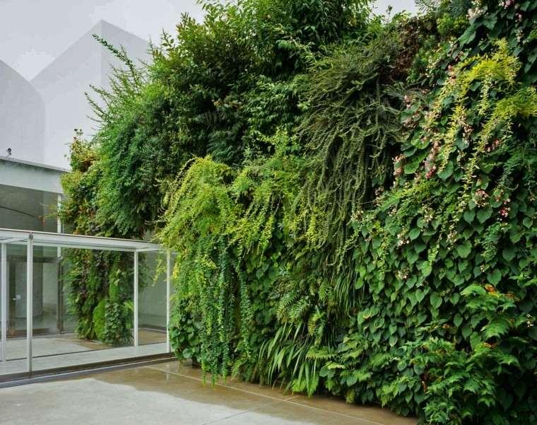 diseño jardines verticales cristales entrada