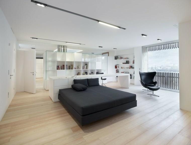 dormitorio amplio estanterias blancas cama negra ideas