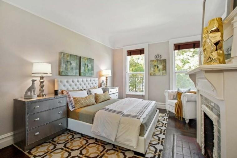 dormitorio chimenea cuadros pared cama blanca ideas