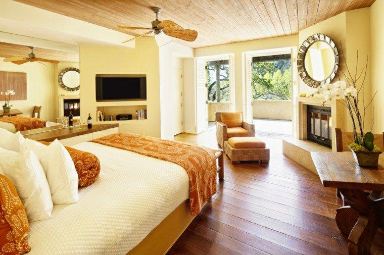 dormitorio chimenea sillon espejo precioso pared ideas