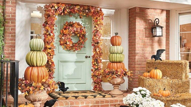entrada casa decorada otono calabazas pajaros ideas