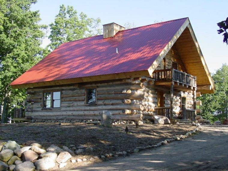 fachada casa rural troncos arboles