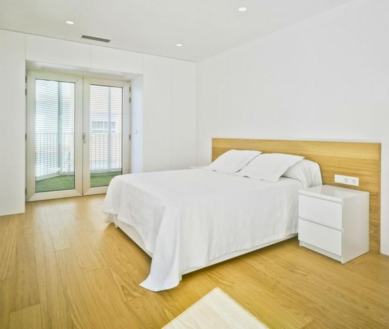 interiores minimalistas dormitorio suelo madera pared blanca ideas