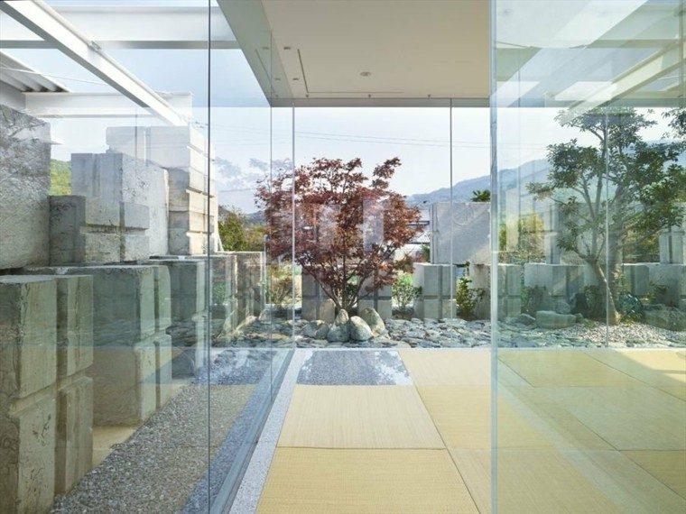 jardin interior paneles vidrio