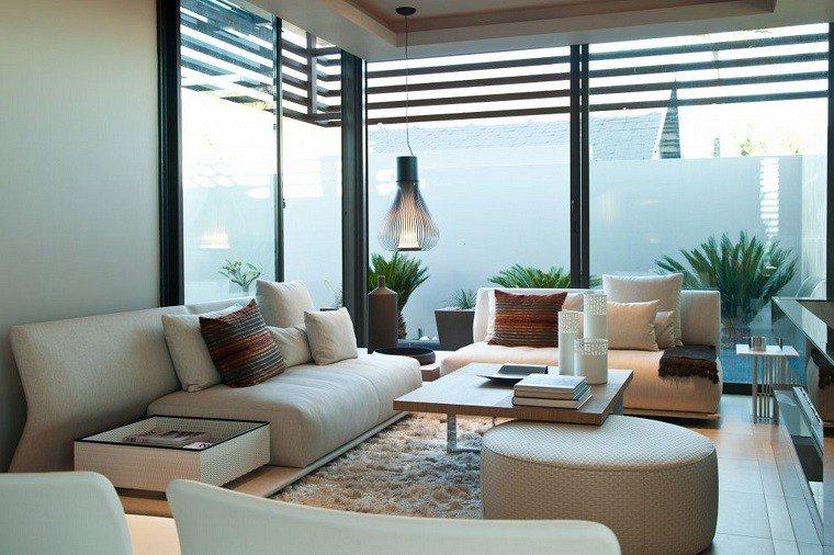 mesa redonda otomana salon moderno acentos cojines ideas