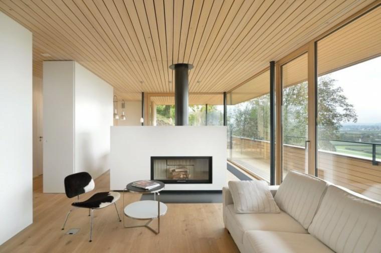 Salones chimenea y decoraci n creando la diferencia for Holzkubus haus