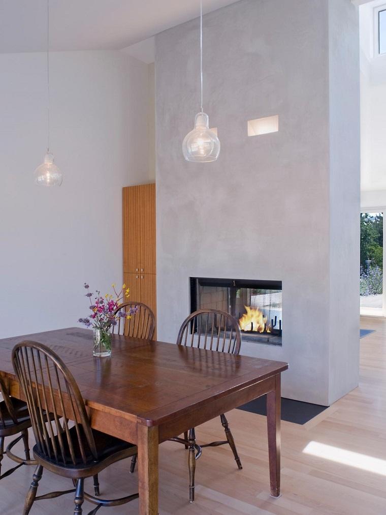 pared hormigon chimenea cristal protector mesa sillas madera ideas