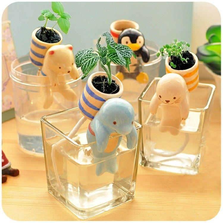 diseño pequeños animales con macetas