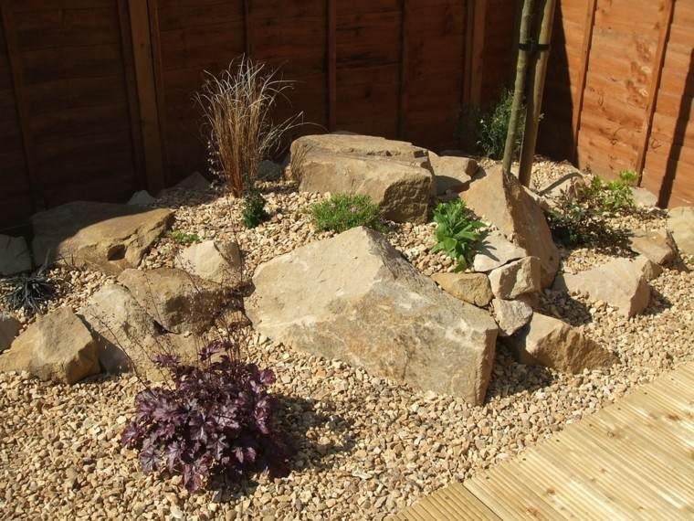roca jardines lamparas valla plantas