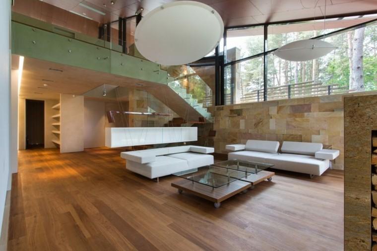 salon amplio luminoso ventanas grandes pared piedra ideas