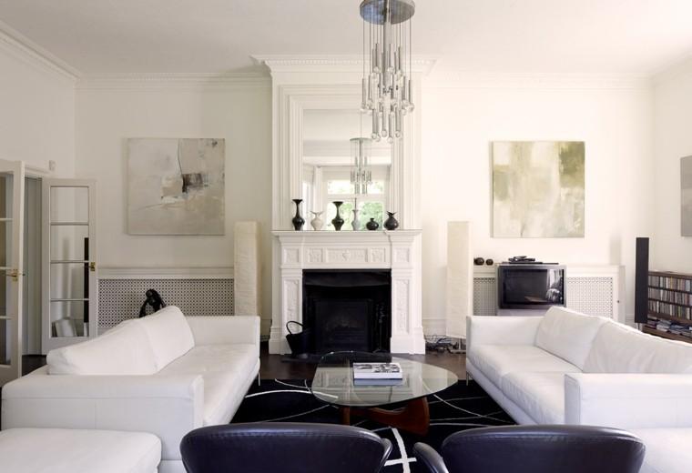 salon amplio pared sofa blanca chimenea alfombra negra ideas