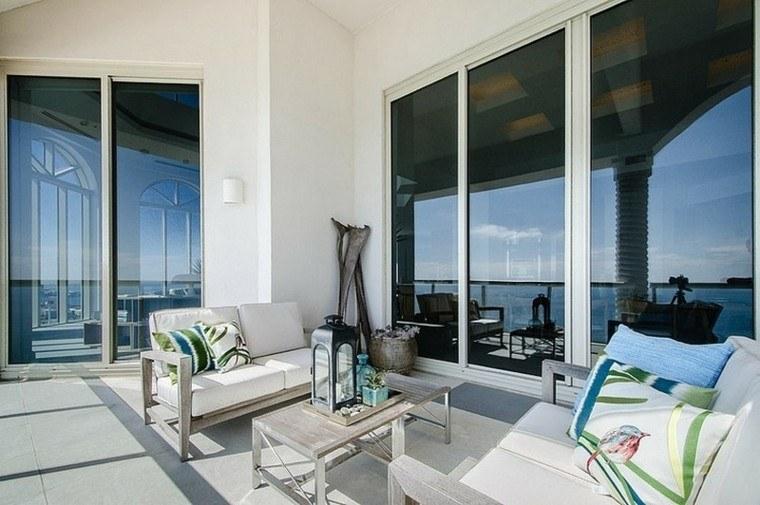 terraza estilo chill cojines verdes