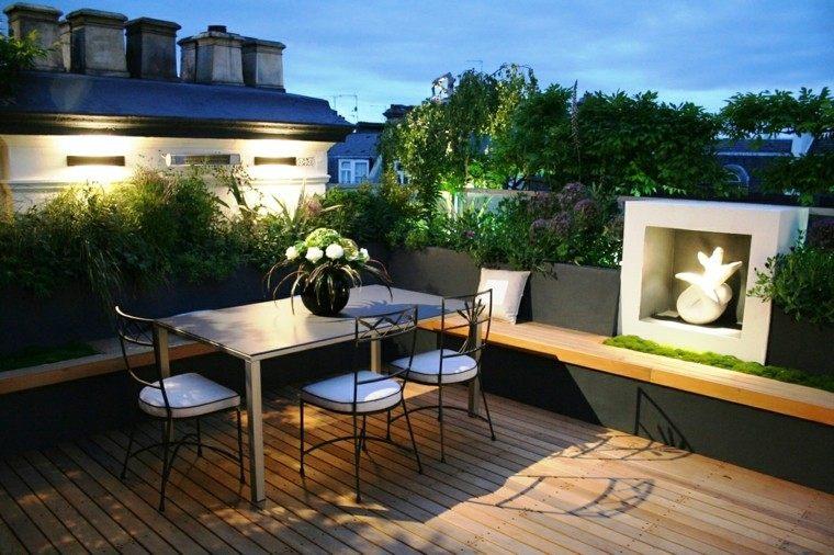 terraza pequena banco hormigon negro figura decorativa ideas