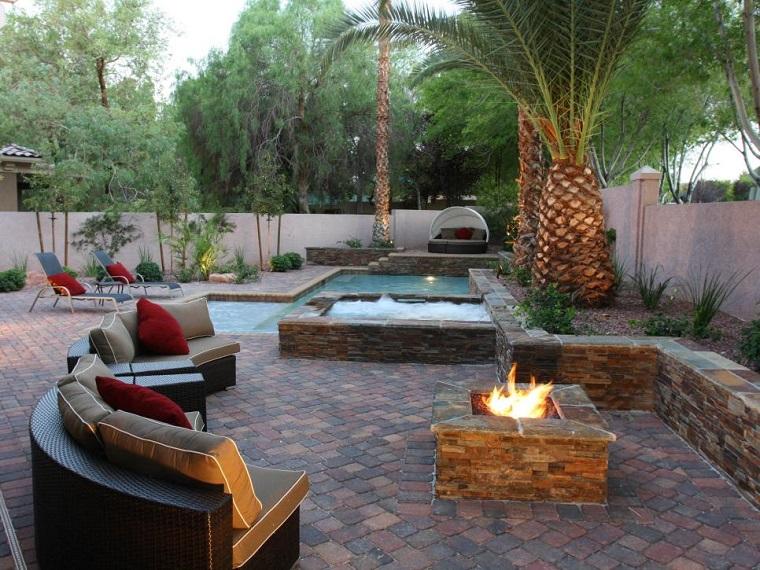 Joseph Vassallo lugar fuego jardin amplio estilo tropical palmeras piscina ideas
