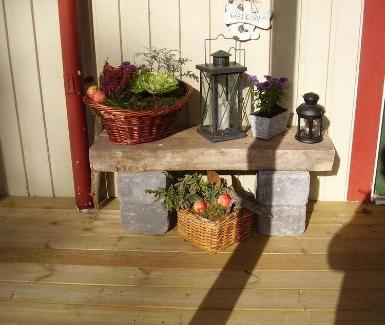 banco piedra improvisado adornos otoño